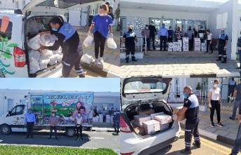 Değirmenlik bölgesinde yaşayan ihtiyaçlı kişilere süt ürünlerini içeren koliler dağıtıldı