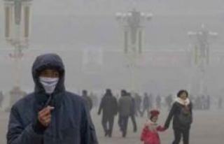 Pekin'de, hava kirliliğini azaltmak için kömür...