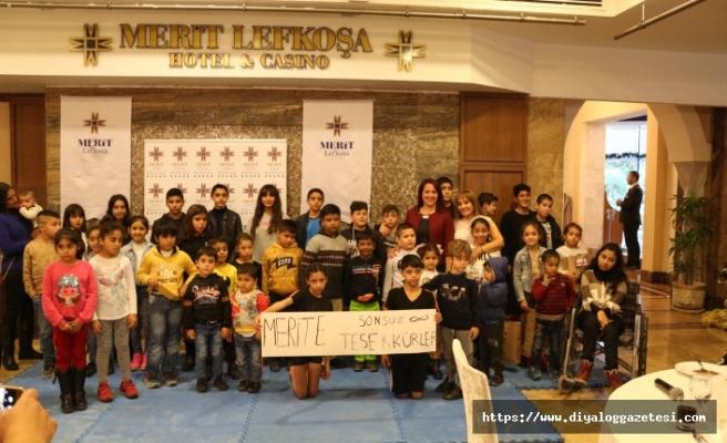 Merit Lefkoşa Hotel, düzenlediği yemekte 100 çocuğa yeni yıl hediyelerini takdim etti